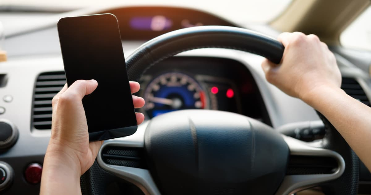 https://www.pexels.com/photo/person-holding-black-smartphone-and-vehicle-steering-wheel-1028742/