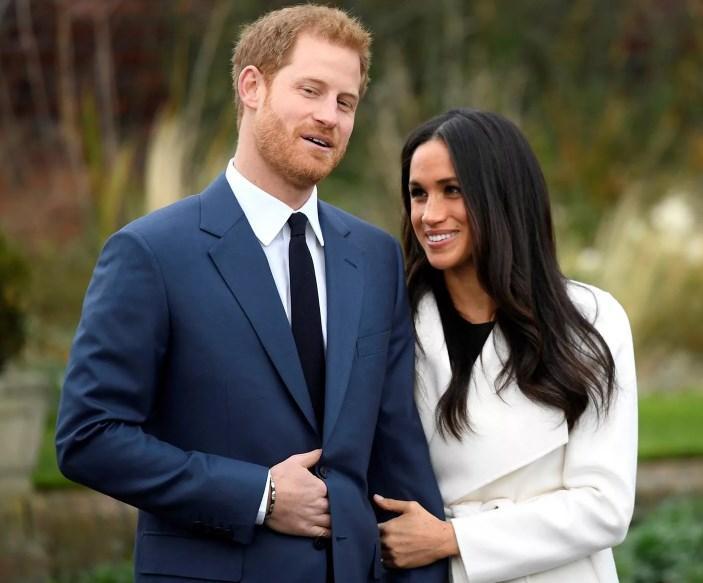 Елизавета II взяла под контроль жизнь Маркл и принца Гарри
