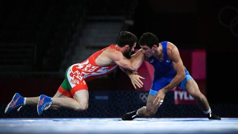 Общество: Кавказское дерби: борец Сидаков выиграл золото в схватке с бывшим россиянином на Олимпиаде в Токио