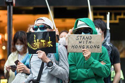 Общество: Китайские шпионы проникли в Британию под видом беженцев из Гонконга